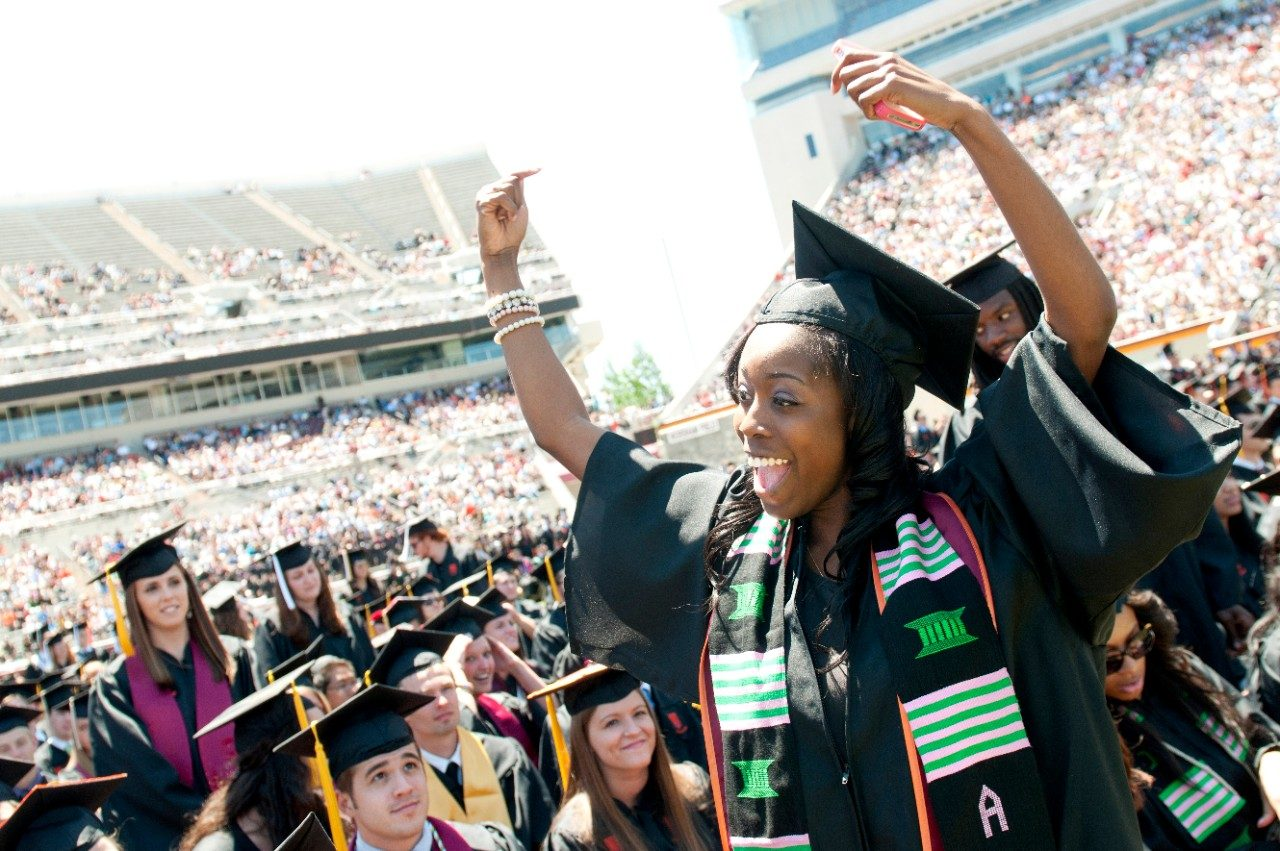 Happy student at Virginia Tech University Commencement at Lane Stadium